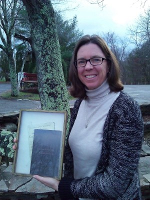 Alumna Jane Dickinson (PhD, 2000) with her Christmas gift for the Dolan Collection